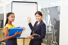 Two business women in statistics presentation Stock Photography