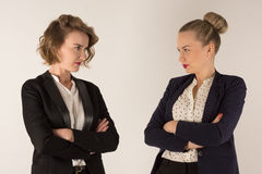 Two business women swear. On a white background Royalty Free Stock Image