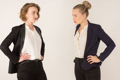 Two business women swear Royalty Free Stock Photo