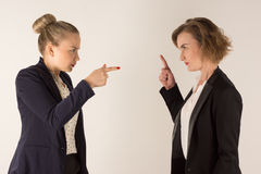 Two business women swear Royalty Free Stock Photography