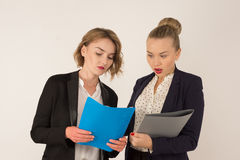 Two business women swear. On a white background Stock Photo