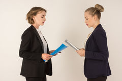 Two business women swear. On a white background Stock Photography