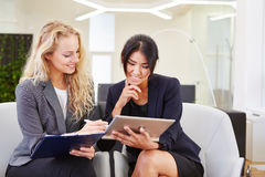 Two business women with tablet Stock Images