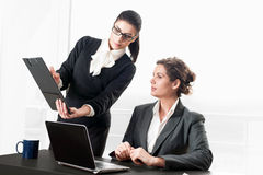Two business women talking over a contract Royalty Free Stock Photo