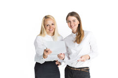 Two business women talking and signing document. Two happy business women talking and signing document Stock Photos