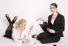 Two business women on a white background. Stock Photos