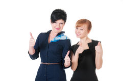 Two business women wih thumb up Stock Photos