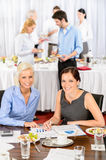 Two business women work during catering buffet royalty free stock image