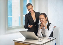 Two business women work at the laptop Royalty Free Stock Photo
