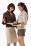 Two business women working Royalty Free Stock Photography