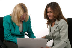 Two Business Women Working On Laptop 7 Royalty Free Stock Images