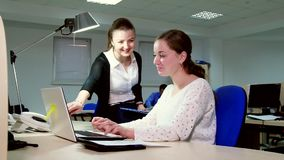 Two business women working in the office at the computer. stock video