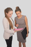 Two business women working on a pink tablet Stock Photography