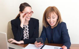Two business women working. Royalty Free Stock Photo