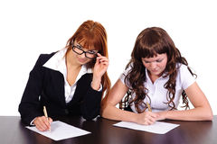 Two business women working together Stock Photos