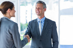 Two business workers shake hands Royalty Free Stock Photography