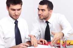 Two businessman argue over some documents. Two businessman have an argument over some paperwork Royalty Free Stock Image