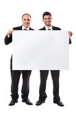 Two Businessman and a billboard Royalty Free Stock Photography