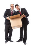 Two Businessman with a box smiling Stock Image