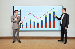 Two businessman and chart Royalty Free Stock Photography