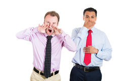 two businessman, co-workers, guys: one being aggressive, angry, yelling out laud, the other keeping his mouth close, shy, modest Stock Photos