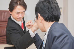 Two Businessman Competing In Arm Wrestling Stock Images