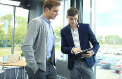 Two businessman dicussing business in the office. Stock Photos