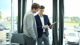 Two businessman dicussing business in the office. Stock Photo