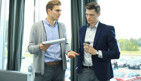 Two businessman dicussing business in the office. Stock Image