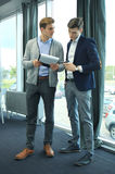 Two businessman dicussing business in the office. Royalty Free Stock Images