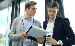 Two businessman dicussing business in the office. Royalty Free Stock Image