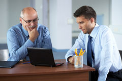 Two businessman discuss something Stock Images