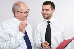 Two businessman discuss something. Stock Photos
