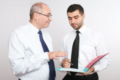 Two businessman discuss something. Royalty Free Stock Photo