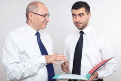 Two businessman discuss something. Royalty Free Stock Images