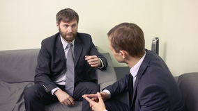 Two businessman emotionally discuss plans. Teamwork two men stock footage
