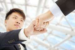 Two businessman fist  collide each other to celebrate Stock Photography