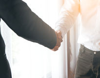 Two Businessman Hand Shaking. To dealing with engineer to building the house Royalty Free Stock Images