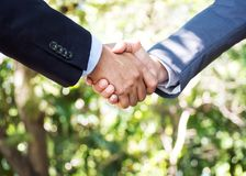 Two businessman handshake together. Sign of Deal successful. Wit Stock Images