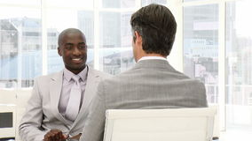 Two businessman having a talk. In the office stock footage
