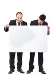 Two Businessman holding a billboard Royalty Free Stock Images