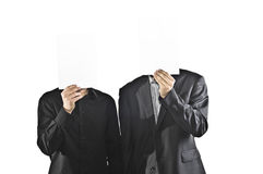 Two businessman holding paper sheets as faces Royalty Free Stock Photography