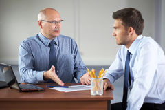 Two businessman with laptop, office Stock Images