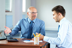 Two businessman with laptop, office Stock Photos