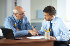 Two businessman with laptop, office shoot Stock Photo