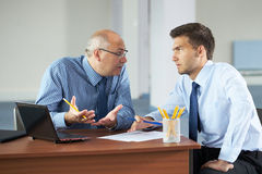 Two businessman with laptop, office shoot Royalty Free Stock Images