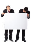 Two Businessman looking at a billboard Stock Photography