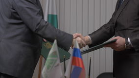 Two businessman with made a deal. Two businessmen shaking hands indicating successfully made deal. 4K stock footage