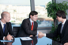 Two businessman making a handshake over a deal Stock Image