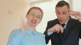 Two businessman man and woman clapping in an office on a window background with shutters. Applause.  stock footage